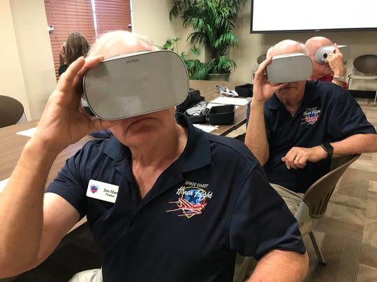 Space Coast Honor Flight president Jim Hart, front, Stu Glass, marketing and public relations director for Space Coast Honor Flight, center, and Lou Seiler, Space Coast Honor Flight videographer, watch the virtual reality tour of a recent Honor Flight trip to Washington D.C.
