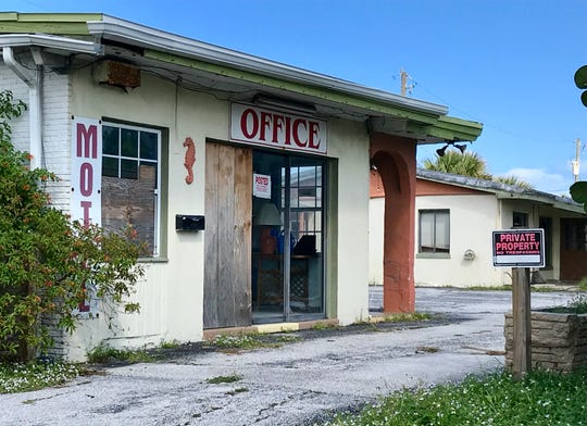The boarded-up office of the Beach House Motel faces State Road A1A in Indialantic.