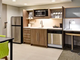 A kitchenette and work space in a typical suite at the Home2 Suites by Hilton (opening April 2020) is seen in this rendering submitted to Williston planners in 2018.