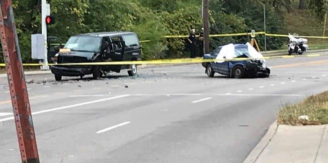 A crash between a car and Oak Hill High School van left the driver of the car dead Monday.