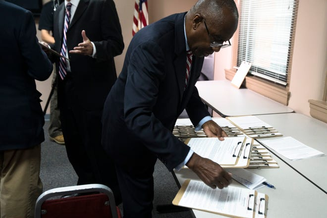 Charlie Winburn, former Cincinnati City Council member, picks up petitions after a press conference about a petition campaign to put the Hamilton County sales tax increase on the ballot at the Hamilton County Republican Party office in Cincinnati, on Monday, Oct. 21, 2019.