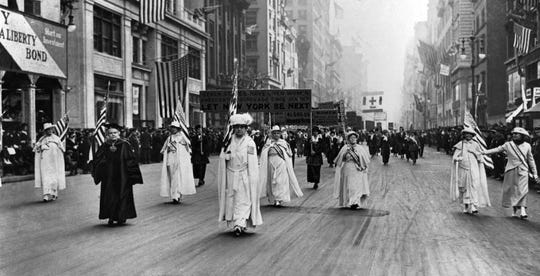 Dr. Anna Shaw and Carrie Chapman Catt, founder of the League of Women Voters, lead an estimated 20,000 supporters in a women's suffrage march on New York's Fifth Ave. in 1915.