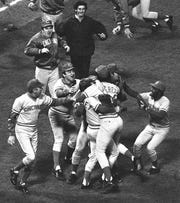 OCTOBER 22, 1975: The Reds celebrate at Fenway Park after winning Game 7 of the 1975 World Series against the Boston Red Sox.