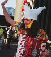 """Weird Al"" Yankovic, on accordion, led the world's largest chicken dance and kazoo band at Oktoberfest Zinzinnati in 1999."