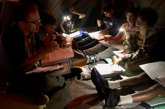 "Jan Macha, a language arts teacher at Soehl Middle School in Linden, talks to his students inside a tent he put up in his classroom. The class is reading Edgar Allen Poe's ""The Tell-Tale Heart,"" and the tent and a darkened classroom add a scary atmosphere to the horror classic."
