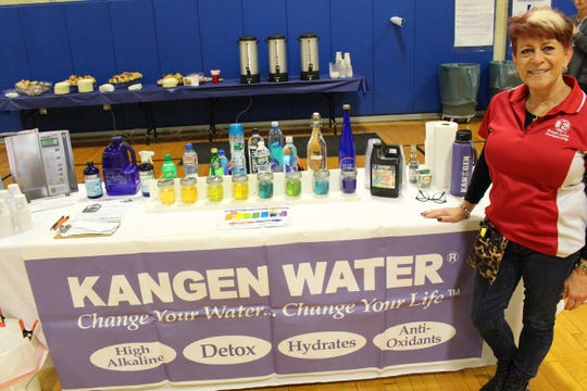 A vendor demonstrating different water qualities.