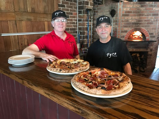 Owner Steve Taylor and head pizzaiolo, Kirby Brown, show off their Neapolitan pies: The Warrior and The Pyra, at Pyra Pizzeria in Norwalk.