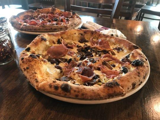 The Pyra pizza from Pyra Pizzeria in Norwalk - a blend of garlic white sauce, Romano cheese, prosciutto, artichoke hearts, kalamata olives, button mushrooms and fresh mozzarella.