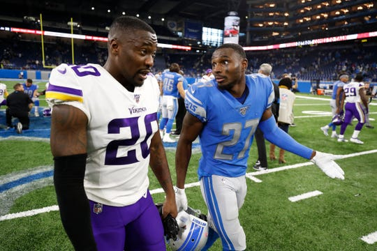 Lions cornerback Justin Coleman talks with Vikings cornerback Mackensie Alexander after the Lions' 42-30 loss at Ford Field.