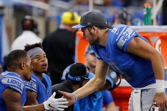 Detroit Lions quarterback Matthew Stafford, right, shakes hands with receivers Kenny Golladay and Marvin Jones during the second half against the Minnesota Vikings, Sunday, Oct. 20, 2019, in Detroit.