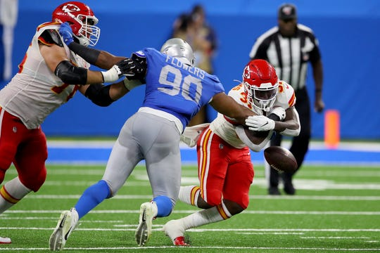 Chiefs' Darrel Williams fumbles against Lions' Trey Flowers during the third quarter at Ford Field, Sept. 29, 2019.
