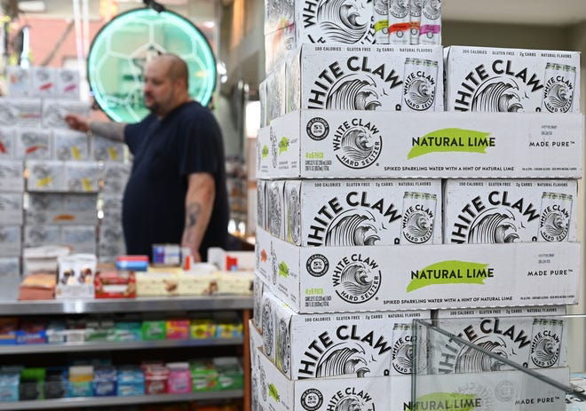 White Claw is preparing to spend $250 million to expand production and alleviate shortages of the drink. (Timothy A. Clary/AFP/Getty Images)
