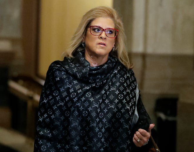 State Rep. Mara Candelaria Reardon arrives for a hearing at the state Supreme Court in the Statehouse, Monday, Oct. 21, 2019, in Indianapolis.