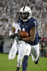 Penn State wide receiver KJ Hamler had six catches for 108 yards and two touchdowns against Michigan.