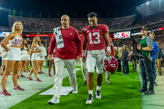 Alabama quarterback Tua Tagovailoa (13) walks off the field during the first half on Saturday.