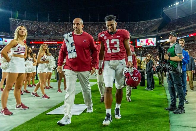 Alabama quarterback Tua Tagovailoa (13) walks off the field during the first half on Saturday.