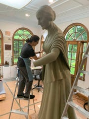 In this Sept. 10, 2019 photo provide by Michael Bergmann, artist Meredith Bergmann works on a sculpture of Susan B. Anthony at her studio in Ridgefield, Conn.