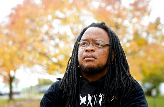 Marlon Anderson poses for a photo Thursday, Oct. 17, 2019 in Madison, Wis. Anderson, a security guard at a Wisconsin high school who was fired after he says he repeated a racial slur while telling a student who had called him that word not to use it, has filed a grievance seeking his job back.