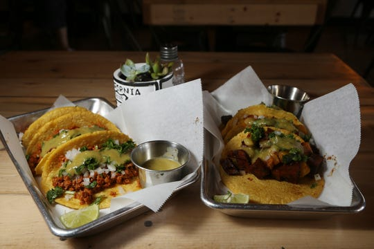 In this Friday, Oct. 18, 2019 photo is two of the taco selections at the Earth Plant Based Cuisine restaurant in Phoenix.