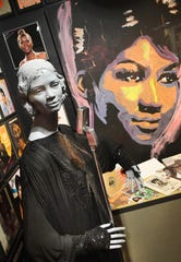 A display on the Queen of Soul, Aretha Franklin, is in the Kid Rock Music Lab at the  Detroit Historical Museum.