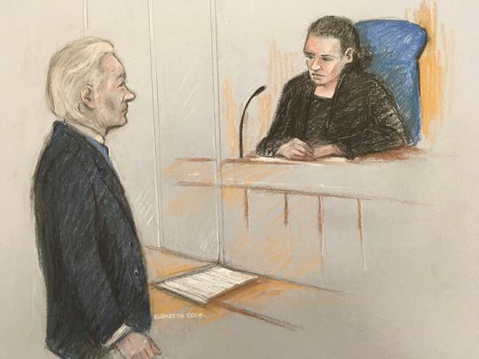 Courts artist sketch by Elizabeth Cook showing Julian Assange facing District Judge Vanessa Baraitser at Westminster Magistrates' Court in London, Monday Oct. 21, 2019.