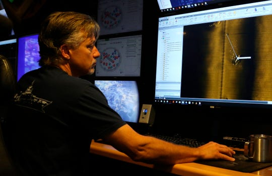Rob Kraft, director of undersea operations at Vulcan Inc., reviews sonar scans of a warship from the World War II Battle of Midway that was found by the crew of the research vessel Petrel, Sunday.
