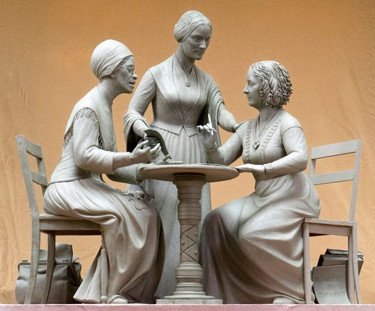 This Oct. 6, 2019 photo provided by Michael Bergmann shows a one-third scale clay model of Sojourner Truth, left, Susan B. Anthony, center, and Elizabeth Cady Stanton at Meredith Bergmann's studio in Ridgefield, Conn. A New York City commission voted Monday, Oct. 21 to erect a tribute to the three civil rights pioneers.