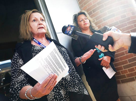 Madison School District interim superintendent Jane Belmore, left, and Madison School Board President Gloria Reyes address questions from the media following a rally in support of fired West High School security guard Marlon Anderson outside the district's offices in Madison, Wis. Friday, Oct. 18, 2019.