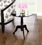 Classic pieces with a twist like a traditional side table with an acrylic finish lend interest to a room.