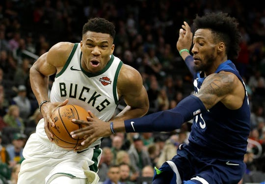 Milwaukee Bucks' Giannis Antetokounmpo, left, has a solid chance to win consecutive league MVP honors.
