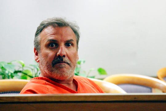 In this Wednesday, Oct. 16, 2019, file photo, Brian Steven Smith looks out in the courtroom while waiting for his arraignment to start in Anchorage, Alaska. Authorities in Alaska say that Smith, accused in the strangling of an Alaska woman seen on a digital memory card, has been charged with another death.