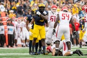 """""""We're just going to keep fighting and keep playing,"""" Michigan defensive lineman Kwity Paye says."""