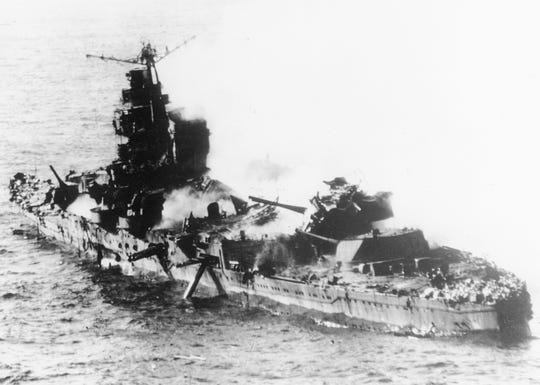 In this May 1942 file photo a Japanese heavy cruiser of the Mogami class lies low in the water after being bombed by U.S. naval aircraft during the Battle of Midway. Researchers scouring the world's oceans for sunken World War II ships are honing in on debris fields deep in the Pacific.