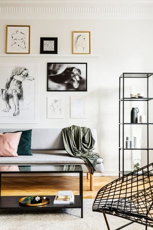 Try arranging a collage of artworks, photos and mirrors on a single wall to create impact in a room.