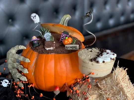 Executive chef John Vermiglio's Pumpkin Tiramisu topped with a whipped-cream mummy and chocolate-covered puffed-rice morsels instead of cocoa, which is used as part of a graveyard scene.