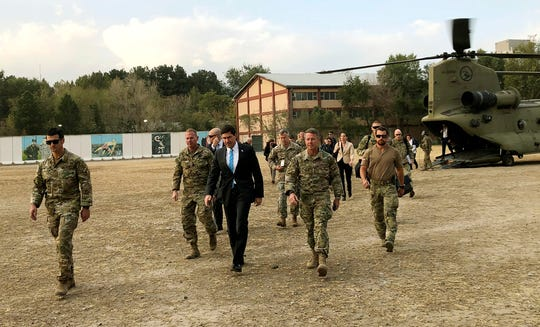 U.S. Defense Secretary Mark Esper, center, walks with Gen. Scott Miller, right, chief of the U.S.-led coalition in Afghanistan, at the U.S. military headquarters in Kabul, Afghanistan, Sunday.