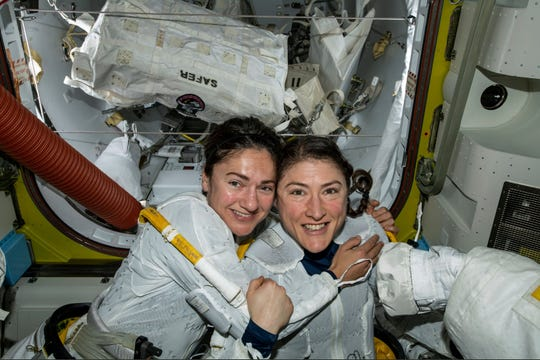 In this photo released by NASA on Friday, Oct. 18, 2019, U.S. astronauts Jessica Meir, left, and Christina Koch pose for a photo in the International Space Station. The astronauts who took part in the first all-female spacewalk are still uplifted by all the excitement down on Earth.