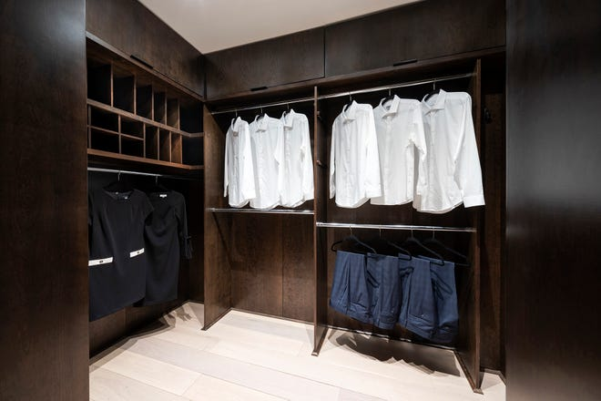 A blend of options for both short- and long-hanging clothing allows for greater versatility in this closet.