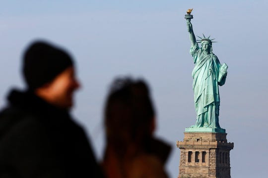 In this Jan. 21, 2018, file photo, tourists ride the Staten Island Ferry to get a view of the Statue of Liberty in New York.