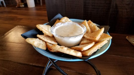 Queso with puffy, lightly crisp fried pita triangles at the Westwood Saloon.