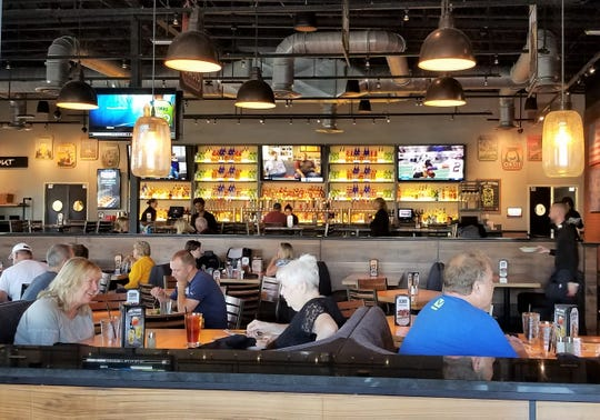 BJ's Restaurant and Brewhouse has a modern interior with a trendy bar and 36 beers on tap.