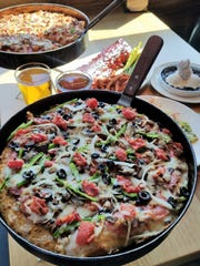 BJ's Restaurant and Brewhouse offers both deep dish and thin tavern-style pizza.