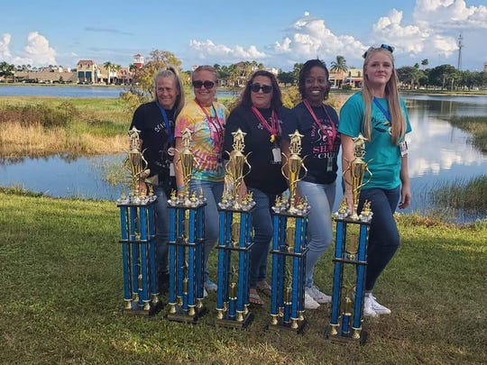 Five Cape Coral Junior cheer squads won conference titles. The winning coaches are Yietta Welch, Keri Punyahotra, Sharon Diggers, Marquilla James and Kelly Bloom.