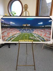 "The one-of-a-kind ""Lambeau in Red, White and Blue"" print will be won by one lucky raffle winner at the Salute to Veterans Dinner Nov. 9."