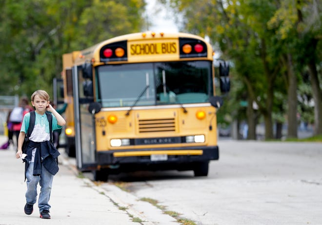 Students leave Jefferson Elementary School in Green Bay at the end of the school day on Oct. 3.