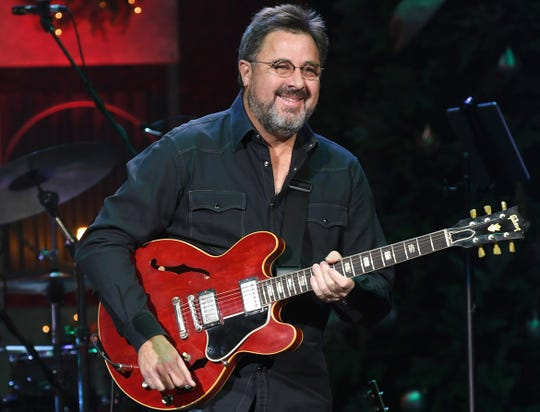 Vince Gill performs last year at the Ryman Auditorium in Nashville, Tennessee.