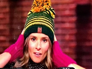 "Danica Patrick models the handmade Packers hat 11-year-old crochet prodigy Jonah Larson made for Aaron Rodgers and gave to her on ""The Kelly Clarkson Show."""