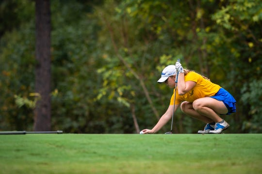 Caitlin Lee, of Wren High School, lines up her shot during the Class AAAA Upper State girls golf tournament at the Preserve at Verdae, Monday, October 21, 2019.