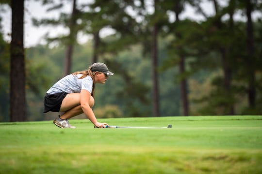 Courtney Collins, of Daniel High School lines up her shot during the Class AAAA Upper State girls golf tournament at the Preserve at Verdae, Monday, October 21, 2019.