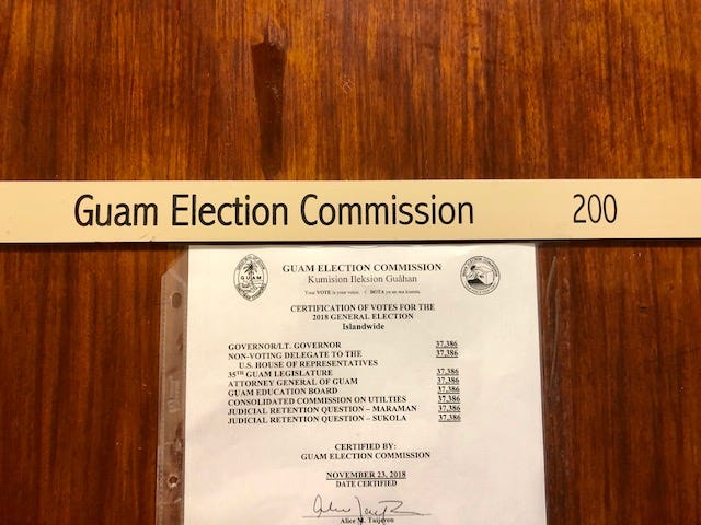 A sign on the door of the Guam Election Commission on Oct. 21, 2019.